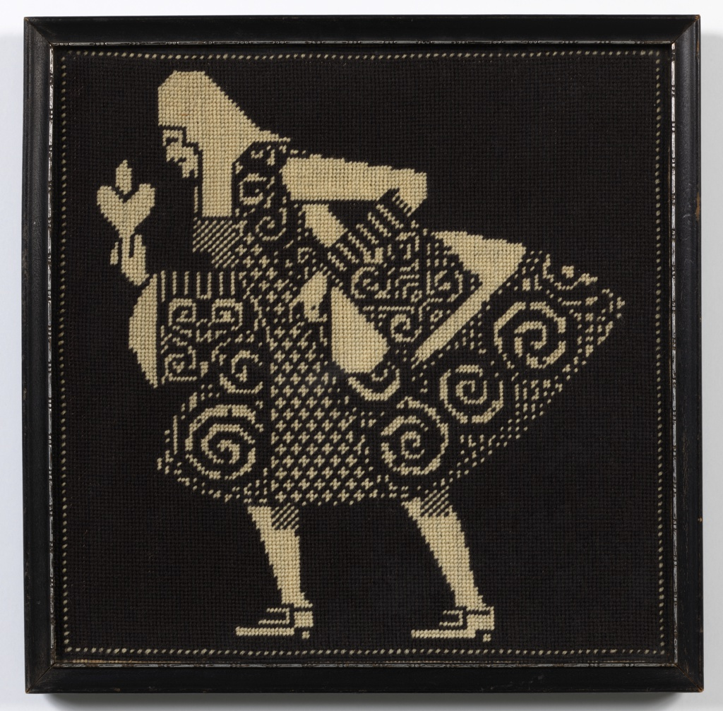 Black and white needlepoint picture of a man in eighteenth-century costume.