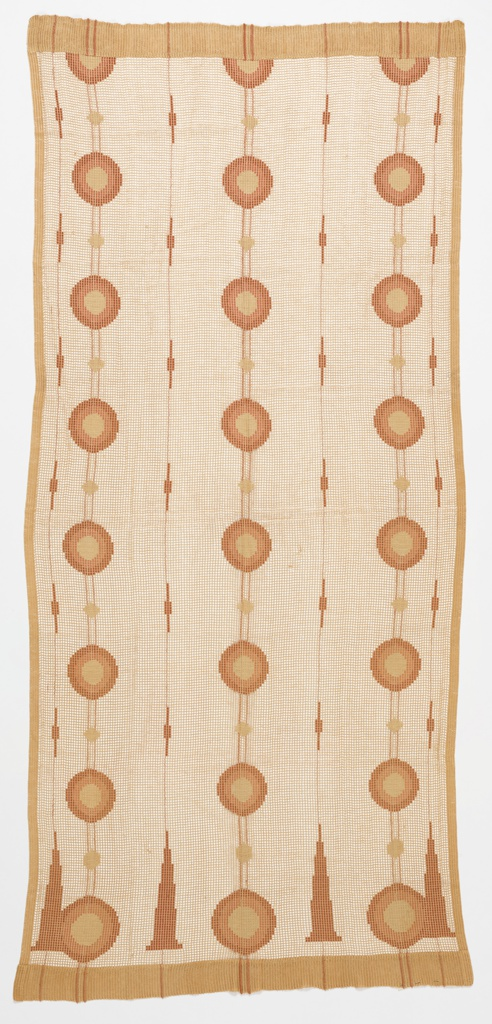 Open weave curtain panel with concentric circles of dark orange, salmon pink and light brown. Elongated triangular forms along bottom edge.
