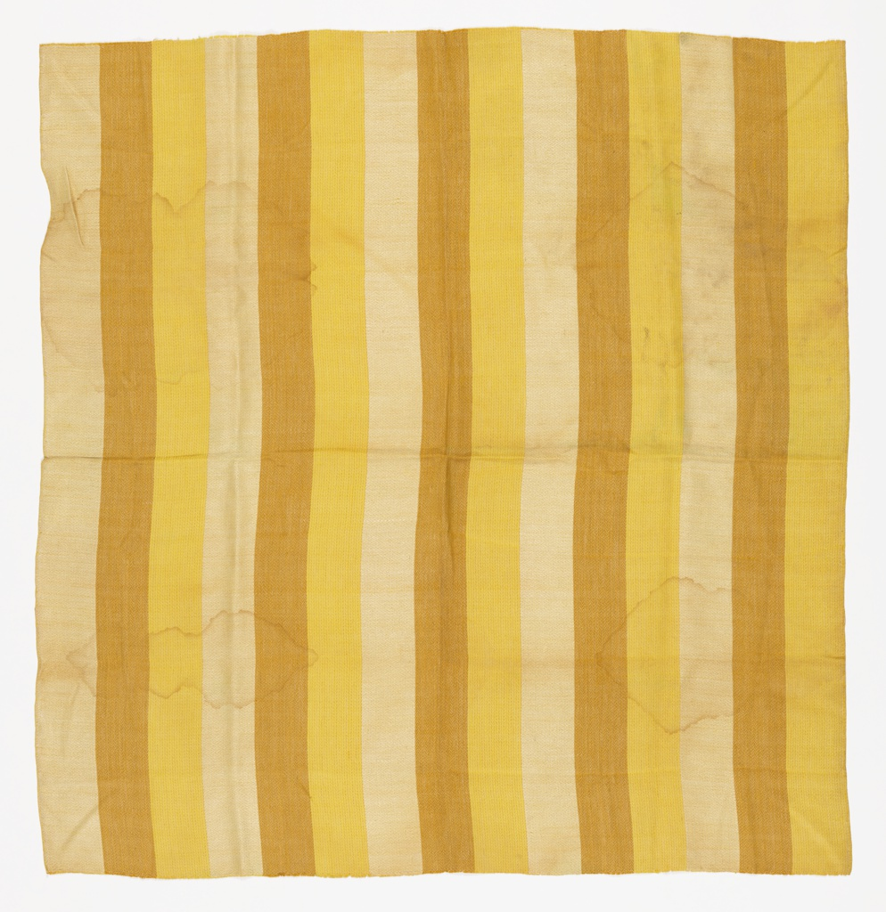 Length of woven fabric has wide vertical stripes in three shades of yellow.