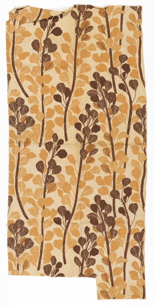 Length of printed fabric with tan and brown vine pattern.