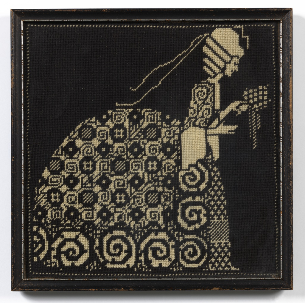 Black and white needlepoint picture of a woman in eighteenth-century costume.
