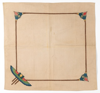 Light brown tablecloth embroidered with a variety of Egyptian revival motifs. Twill tapes on reverse.