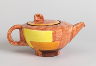 Hemispherical body (a) with slightly domed top, low cylindrical foot, angled conical spout, and D-shaped handle; circular lid (b) with curved tab handle set off-center. Mottled underglaze decoration of light brown field with geometric panels in yellow, orange and dark brown.
