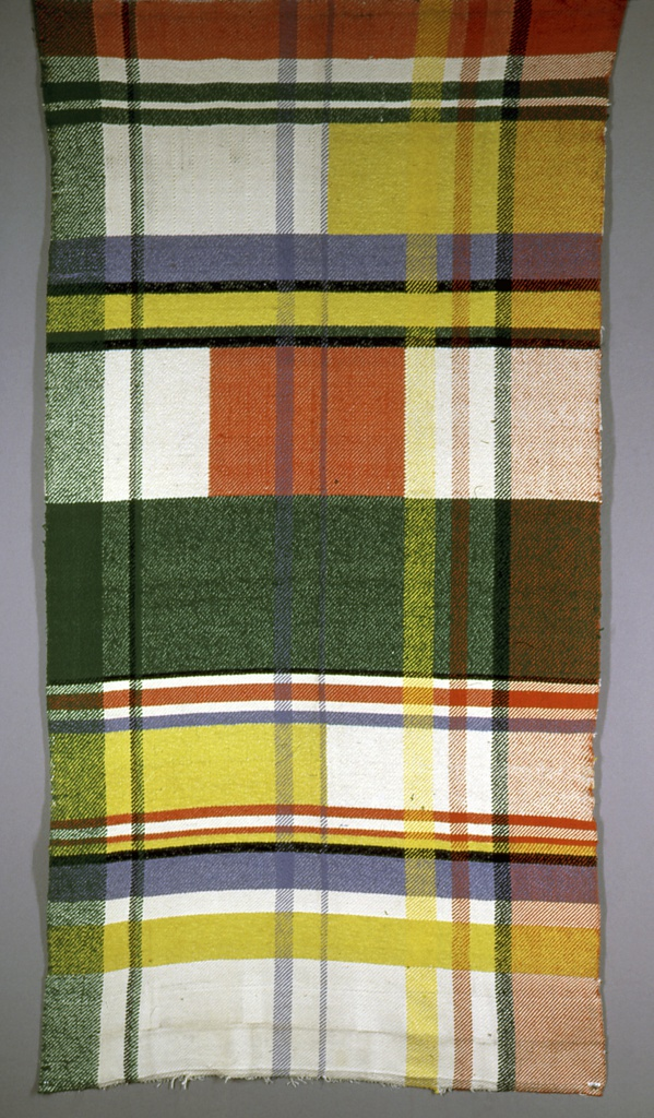 Unbalanced plaid of white, green and orange with yellow, lavender and black.