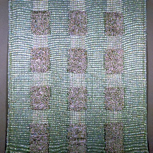 Length of woven fabric with a foundation of celadon green, off-white, and silver metallic. Broad vertical stripes are broken up by rectangles of long, off-white uncut loops.