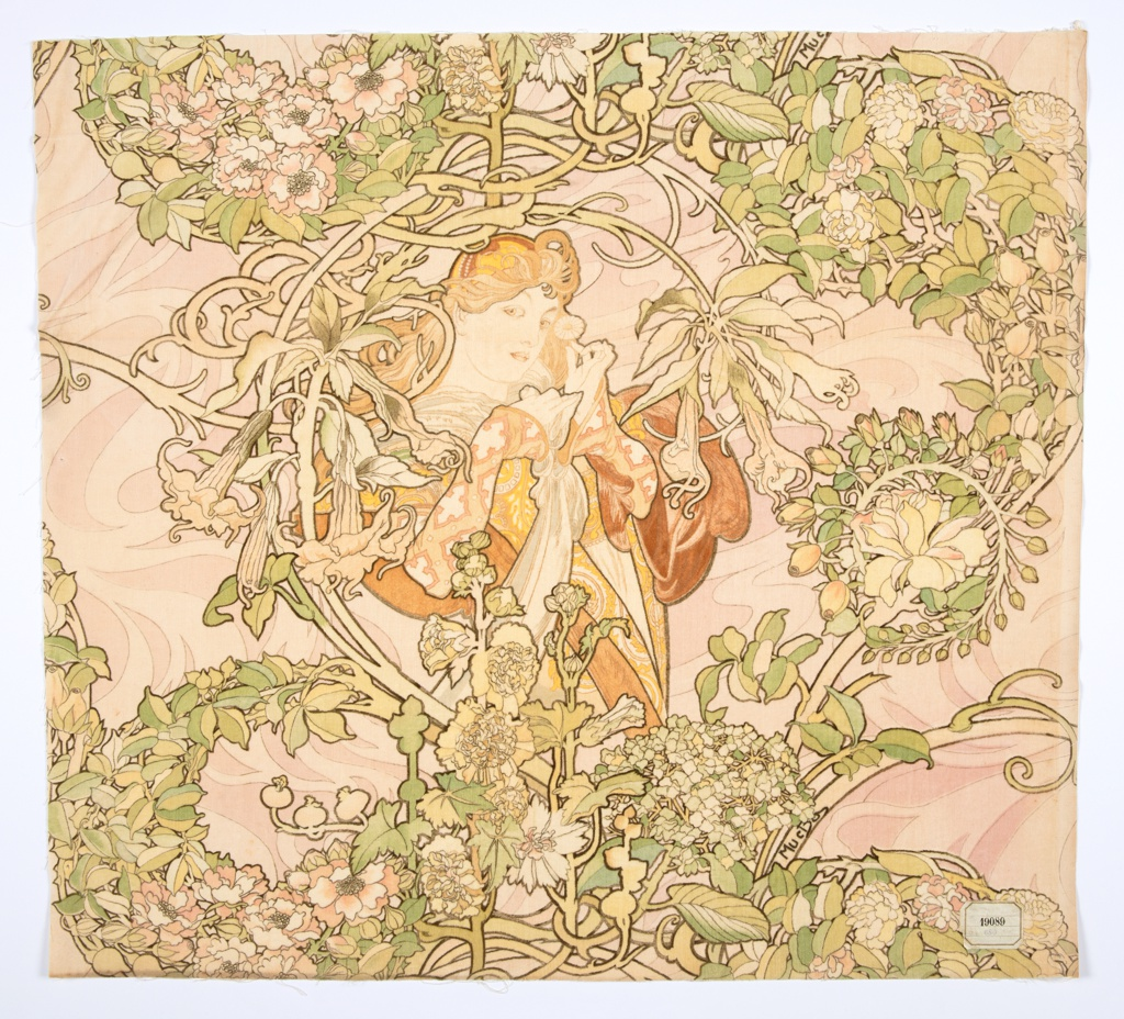 Piece of printed velvet with a young woman in medieval dress with flowing hair, holding a daisy and standing amidst a swirling profusion of branches and flowers, in shades of brown, rust, green and yellow on a pale pink ground.