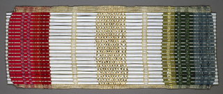 Sample of a woven window blind with rigid wefts. Warps are spaced and striped blue and green on one side and red on the other with gold in center. Wefts are alternately a half round, half-inch dowel and a full round one-eighth inch diameter white reed.