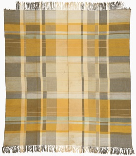 Bauhaus-influenced plaid tablelcloth in shades of yellow, pale green and gray. Fringe on two sides.