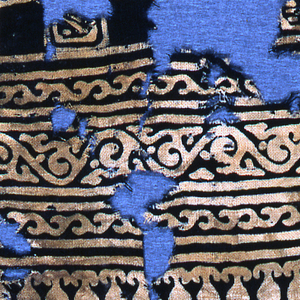 Fragment of a panel with a squared grid field and three-part vine border with pendant edge. White design on blue ground.