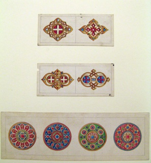 Middle drawing in image. At left: In the center are two circles, similar to -63-56 left, connected by a rectangle.  The arch framed by a pseudo-gothic form.  At right: A similar central motif; the circles containing red crosses upon blue are framed by an angularly entwined band.