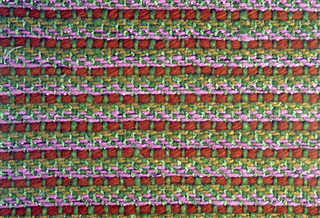Green, pink and orange twill. Warp is green boucle alternating with green 2-ply yarns. Weft has repeating sequences of three 3-ply gold yarns, three 2-ply pink yarns paired with a flat pink metallic thread, and one 6-ply orange yarn.