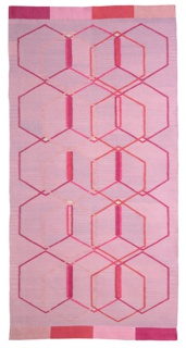 Rectangular textile with quinoidal pattern, woven with a palette of light pink, red, deep pink, and purple.