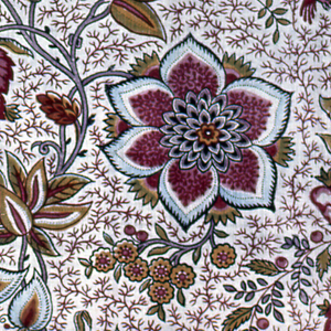 Fragment of printed cotton with an all-over design of intertwining branches with large, exotic flowers and pairs of birds; background is filled with fine red vine. In blue, green, yellow, and several shades of purple, red and pink on an off-white ground.