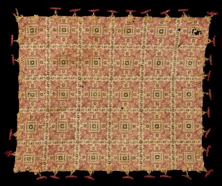 Panel of linen divided into squares by bands of drawn-work; each square ornamented by drawn-work and embroidery in red silk. Toggles of red and yellow silk are fastened at the edge of the pillow cover by braided ornaments of yellow silk. Stitches using silk: back for linear pattern. Withdrawn element work with overcasting and interlacing using silk.