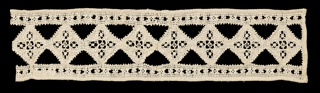 Woven linen band showing design of interconnected diamonds with narrow borders on top and bottom. Each diamond has five small squares filled with tiny needlemade filling stitches.