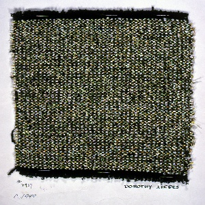 Plain weave of black and white boucle with synthetic gold. Warp is black boucle alternating with two-ply black yarn. Weft is textured white and gold yarn alternating with flat gold paired with wrapped gold thread.