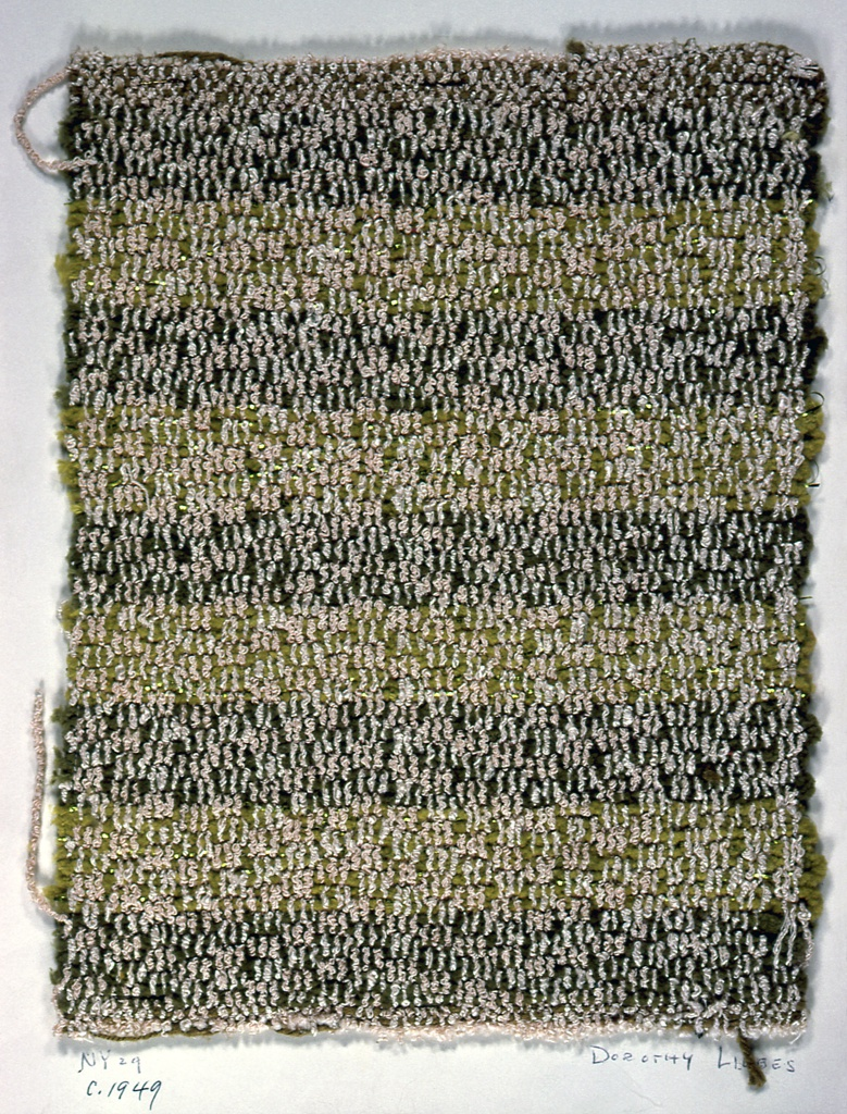 Plain weave variation in which groups of six warps operate in plain weave with paired wefts and then the next six move up half a step for an alternate pairs of wefts, repeated across width. Warp has two shades of pink boucle alternating. Weft has stripes of chenille in two shades of green, the lighter shade paired with flat metal yarn.