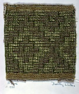 Plain weave variation in which some warps float over two wefts in order to create pattern. Warp of paired beige synthetic yarns alternate with three strands of wrapped metallic yarn. Weft is green two-ply cotton alternating with green synthetic paired with flat metallic yarn.