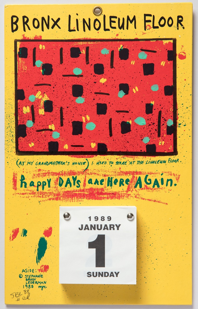 Illustrated board with with grommet for hanging and a bolted-on page-a-day white paper calendar with black lettering. Red, black, yellow and teal patterned rectangular area, against yellow background. Effect of splattered paint throughout.