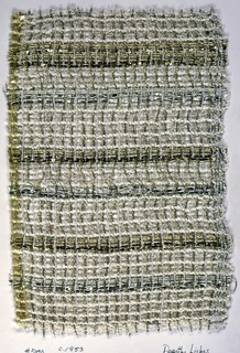 Open plain weave with 3 span floats of every 4th warp on shed A & B. Paired and unpaired warps are in a variety of yarns in white, gold and silver. Warp: repeating pattern of white flake yarn, transparent chained plastic, wrapped silver yarn, wrapped gold yarn paired with 2 ply gold yarn.  Weft: chained transparent plastic, alternating wtih white boucle yarn; flat, wrapped and braided silver; flat wrapped and braided gold yarn.