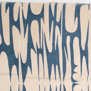 Printed fabric with an abstract, organic design, symmetrical on a central vertical axis as well as horizontal axis. Printed in blue on white.