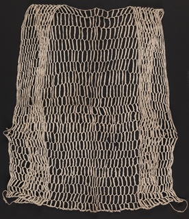 Vest which opens at the front; fronts connected to back by two twisted strands on each side. Hexagonal mesh of plaited recycled paper; handwriting on the paper reads as irregular black spots.