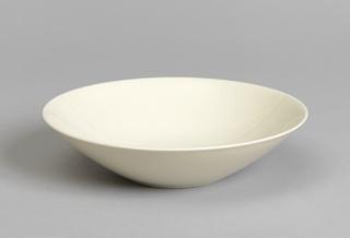 White circular bowl flaring to large circular mouth.
