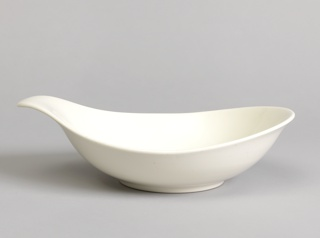 White teardrop shaped dish with everted handle, circular foot ring.