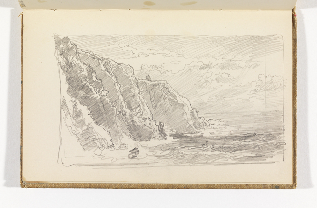 Choppy seas with four cliffs on right, structure on top of fourth cliff.