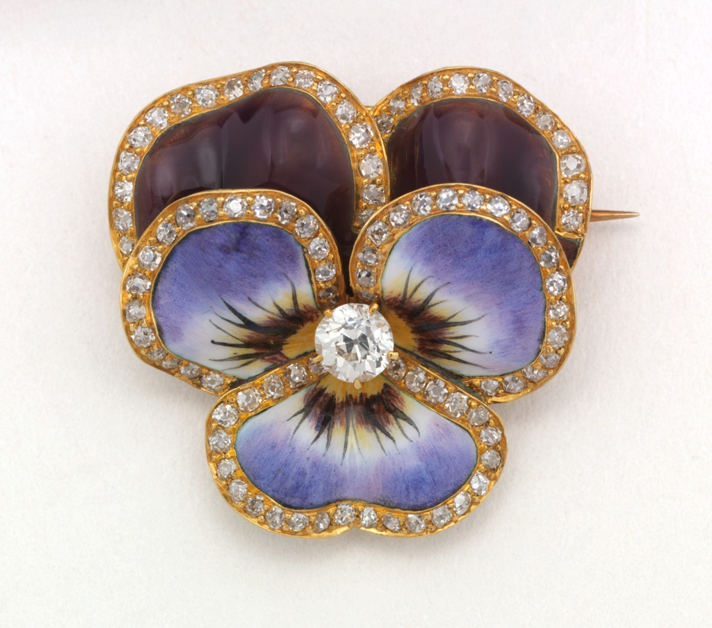 """Enameled gold brooch in the shape of a flower with diamonds along the perimeter of """"petals"""" and diamonds in the center. On reverse: gold bar pin and small collapsible ring for hanging as pendant."""