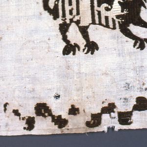 Breadth of soft course cloth with two squares of embroidered decoration: in one square, mythological beast (related to Mude jar lion (?) ) with palmate feet, long tail with leaf ending , stylized mane, etc., in dark brown wool; white eye and white bird with spread wings, composite flower, in brown wool; white leaf embroidered on breast; white collar. Squares outlined in simple checkered border, with checks rounded on three sides in dark brown wool.