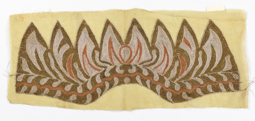 Panel embroidered to shape for a hat. Dense metallic bronze, copper and silver couched cord embroidery in exotic pattern on linen ground.