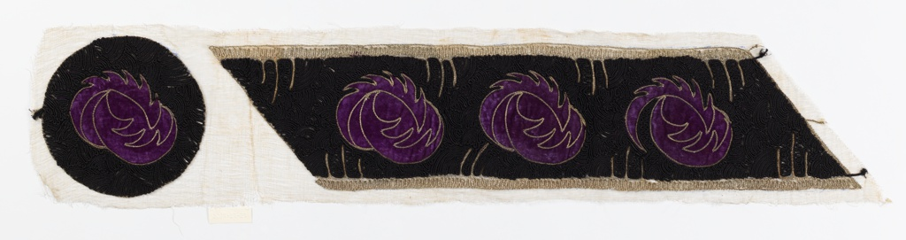 Embroidered band and medallion. Black couched cord soutache embroidery with purple velvet rosette appliqués and silver metallic couched details, on coarse gauze ground.