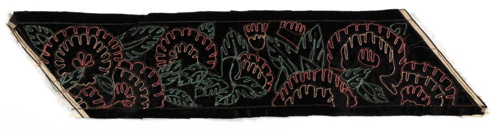 Black velvet band with open floral pattern embroidered in metallic gold, turquoise and pink chain stitch.
