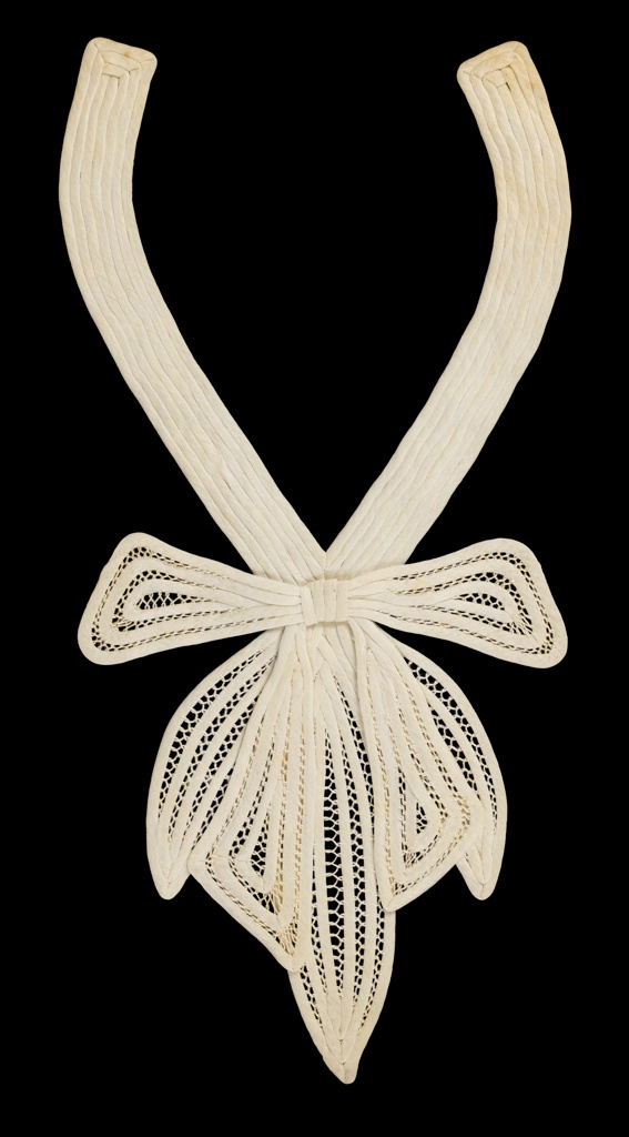 Passementerie for a dress front/collar. Fine white muslin tubular strips, stitched together with openwork bar accents, large bow with openwork pendants. 1930s.