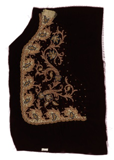 Dark rayon velvet appliquéd with a cream-colored silk in a curvilinear shape. Silk design is embroidered and embellished with multi-colored beads in floral and scrolling forms.