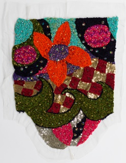 Couture sleeve embroidered in chenille and foil threads in green, turquoise, orange, pink, purple, red, and dark blue.  Pattern shows stylized flower surrounded by squares and swirling shapes.  Some areas worked solidly in gold and silver sequins.  Rhinestones and colored glass stones superimposed overall.