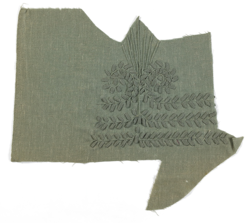 Sage green crepe, with interlaced tone-on-tone picot-edged ribbon embroidery in scrolling vine pattern, pin-tucked fan shape detail.