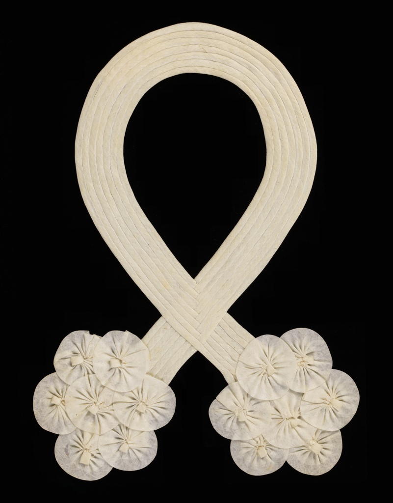 Passementerie for a collar. Fine white muslin tubular strips, in an interlaced loop with shirred rosette clusters at each end. 1930s.