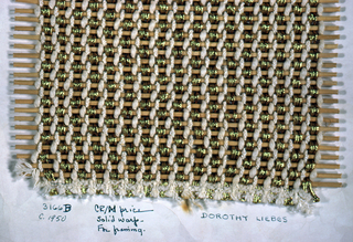 Sample with paired and unpaired warps of white string, white boucle yarn, gold braided metallic and copper braided metallic over a central core. Wefts are circular reeds.