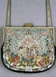 Small handbag of fine petit point , squared at top and rounded at base, on a silver gilt frame with imitaition pearls. Symmetrical floral design with butterflies.