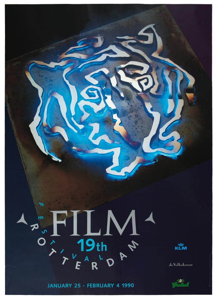 Poster for the 19th International Film Festival Rotterdam. Central image is the face of a tiger, rendered as if drawn in a metallic substance, glowing blue against a dark background. Beneath, 'FILM' in gray, '19th' below in teal; curved to left and below, 'FESTIVAL' in teal, below, curved, 'ROTTERDAM' in gray. At bottom center, in teal, 'JANUARY 25 - FEBRUARY 4 1990'