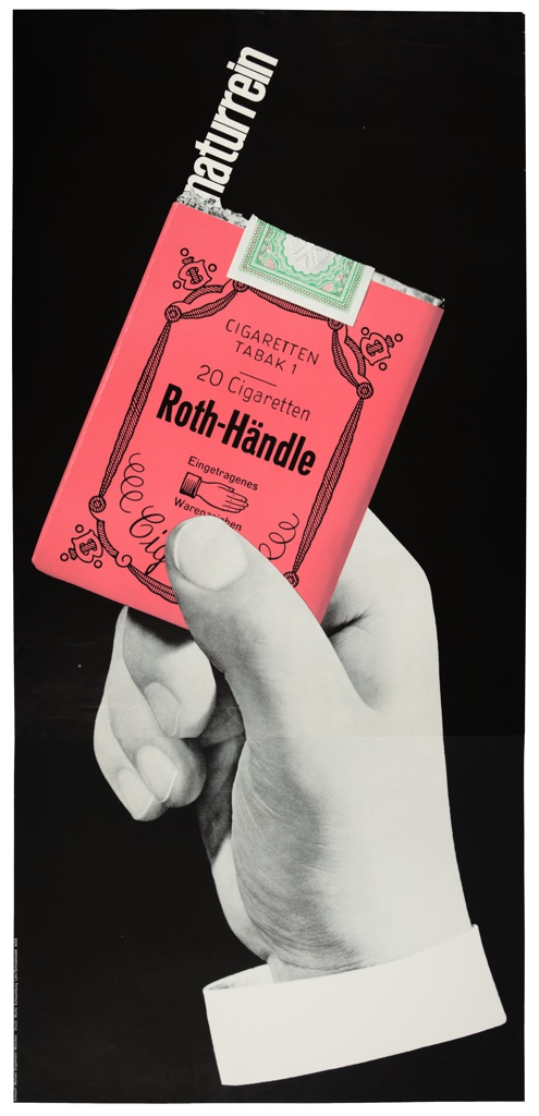 Against a black ground, a large black-and-white photographic image of a hand grips a rosy-tinted cigarette package, out of which the word 'naturrein' emerges, as would one of the cigarettes.