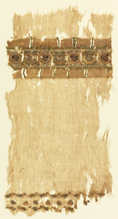 Tiraz fragment of linen with part of a silk and metal tapestry tiraz band at top, and at bottom, rows of small silk tapestry insets.  Ground of tiraz band loosely woven on linen warps with gold silk originally wound with metal; row of small adjoining roundels enclosing alternately a frontal human mask or a bird in profile, with outlines and details in fine silk tapestry in sky-blue, yellow-green, white, black on the looser gold ground, narrow sky-blue silk guard band above and below roundels separates row or roundels from pale yellow-green silk Kufic inscription with details in black and white filling upper and lower third of tiraz band (lower inscription upside down).  Small silk and metal tapestry insets woven on warps of the linen ground consist of row of small birds facing left in gold silk originally wound with metal, with touches of green, blue, white, black silk; row of rosettes alternating with heart-shaped petal, in same colors; row of small birds facing right.