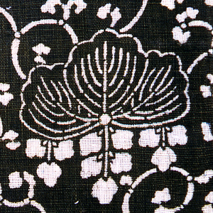 Stylized over-all repeat of Pawlonia leaf and flowers in continuous scrolls.