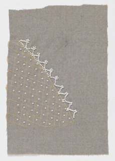 Grey fabric partially embroidered in a diaper pattern worked in white silk thread and punctuated with a single bead in each diamond. Beads in a repeating triangle pattern run along one edge.