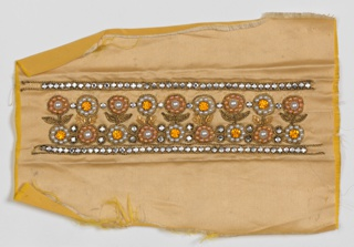 Pale yellow satin ground embroidered in a band outlined in rhinestones. Band contains flower design worked in faux pearls with pink and orange round beads and rhinestones outlined in gold cord.