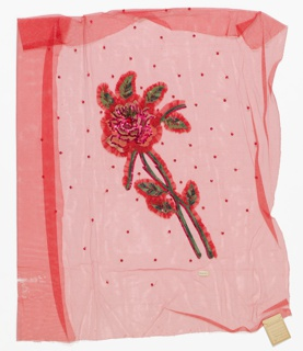 Panel of brilliant red net appliquéd and embroidered in a design of a rose stem with leaves. Rose spray in machine imitation of chain stitch with red sequins, green glass beads, and a large red glass bead at center. Outlined with ruffles of net.