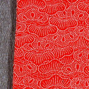 Small square pad patterned with stenciled paste resist of small dots (komon). All-over pattern of pine trees. In bright orange.