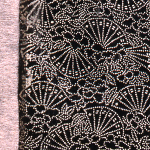 Allover pattern of fans and peonies composed of tiny white dots on a black background. Kitri-bori (awl carving).